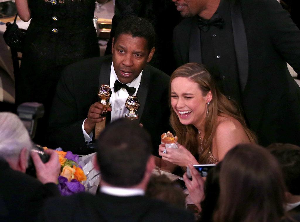 Denzel Washington cracked up Brie Larson who eating burger 96c5a