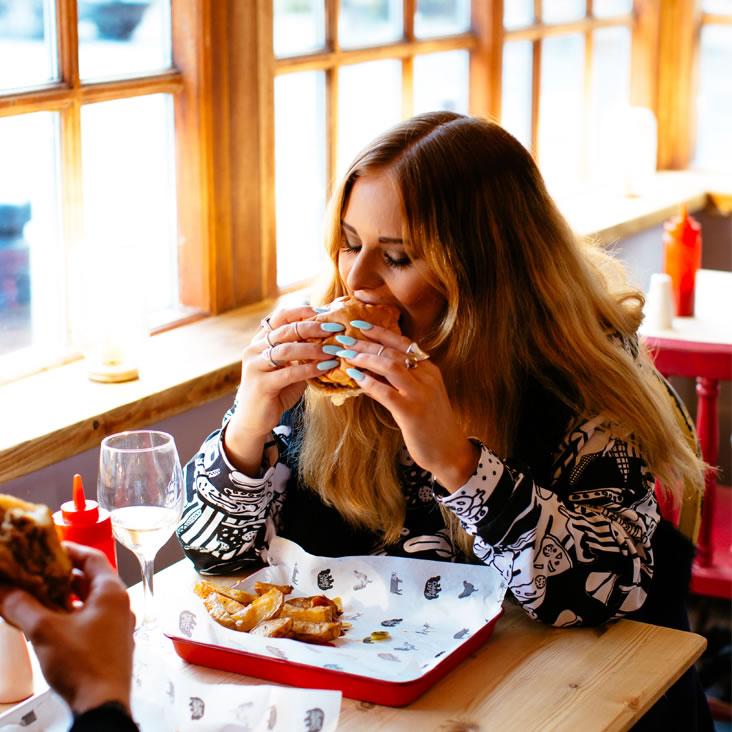 girl eating burger Jesmond SQ